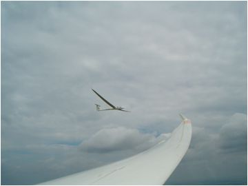 Two gliders in flight, wing of a soaring sailplane